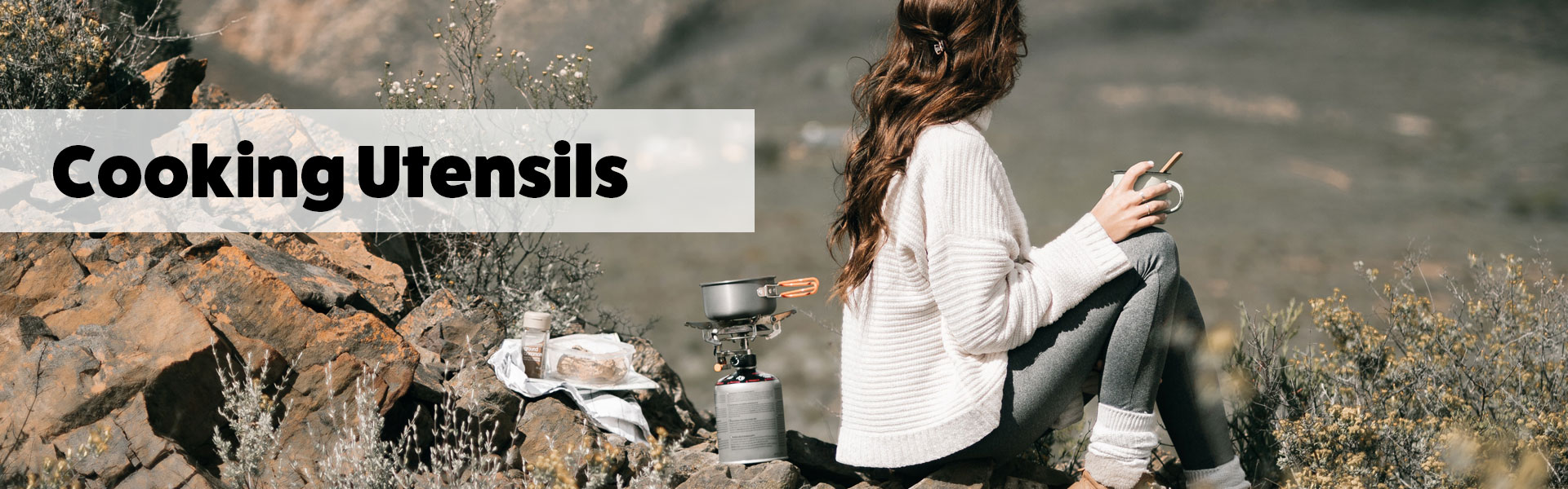 Cooking Utensils With A Girl Sitting In The Mountains